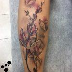 קעקוע פרח בסגנון צבעי מים